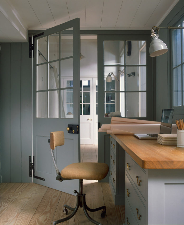 a loft style home office with glass panel doors (Plain English)