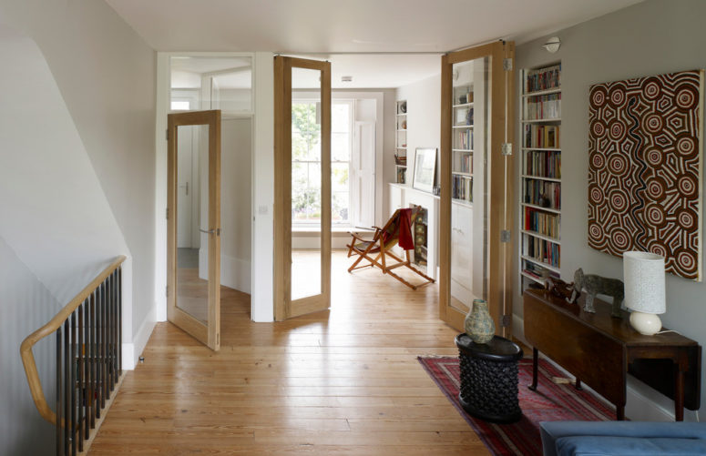 folding glass doors are used to separate two rooms where standard interior doors couldn't be used (Prewett Bizley ltd)