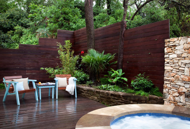 Dark stained wood fence looks amazing among greenery. (B. Jane Gardens)