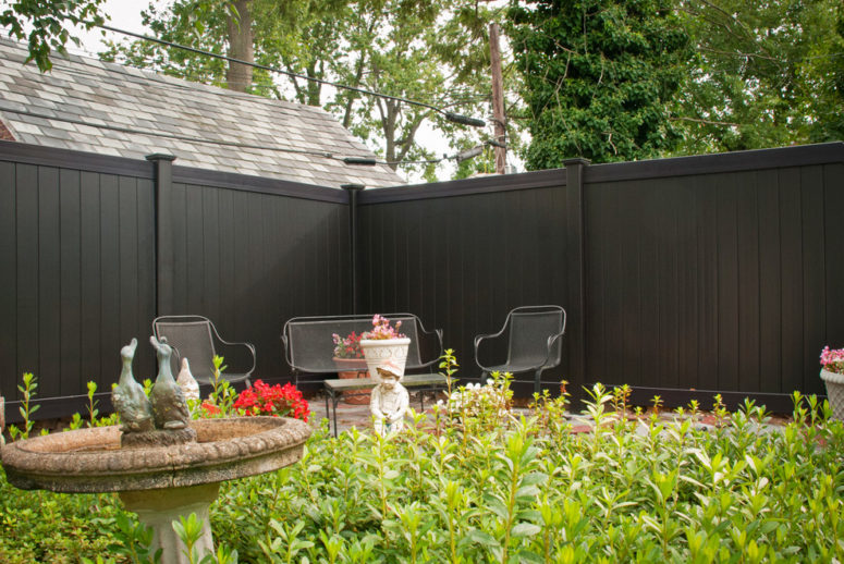 Black PVC vinyl privacy fence is perfect for those who like contemporary style. (Illusions Vinyl Fence)