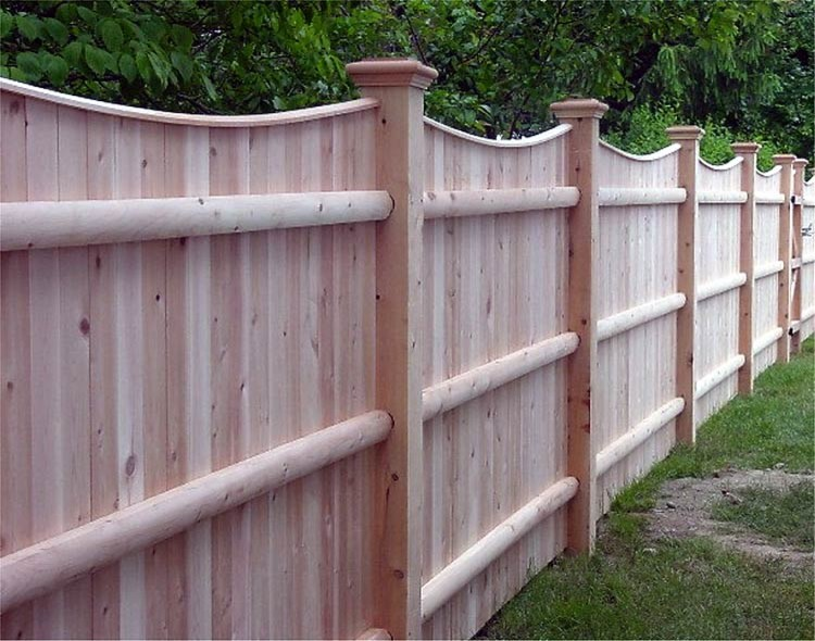 A solid fence with capped scalloped top and three doweled backing rails for strength is a super sturdy solution. (AVO Fence & Supply, Inc.)