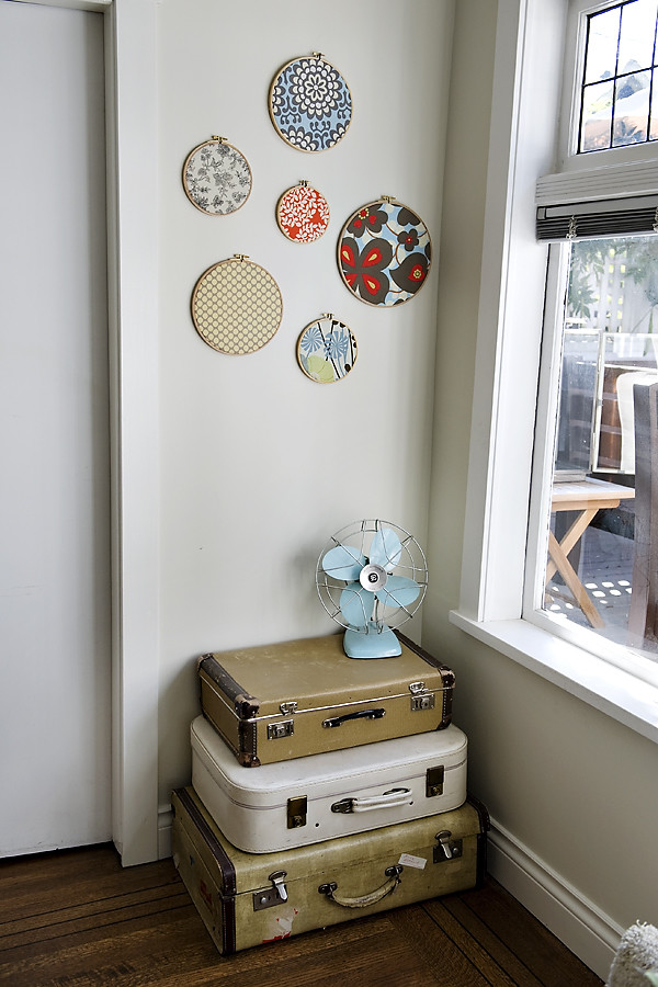 a stack of old suitcases fit nice into an awkward corner and even acts as a console table