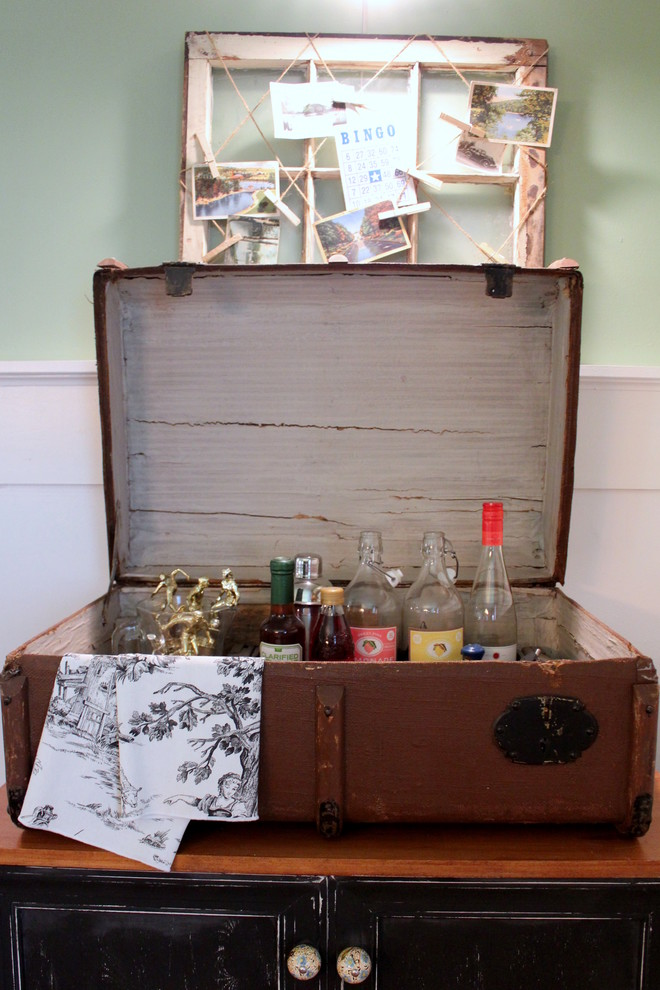 a small home bar could fit into a large vintage suitcase