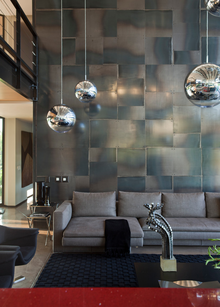 a large wall of this family room is covered with steel cladding (Nico van der Meulen Architects)
