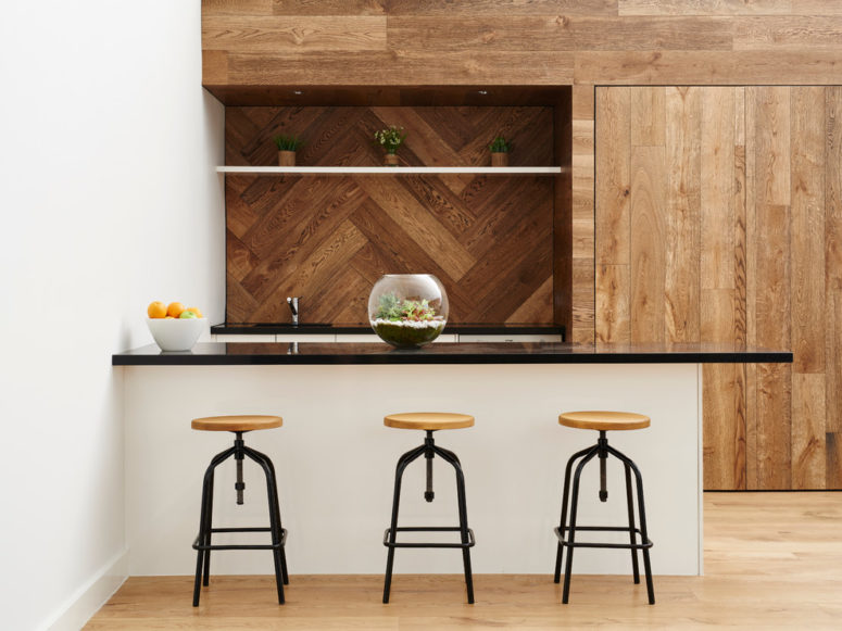 wood planks clad in a chevron pattern makes a great accent wall (Kustom Timber)