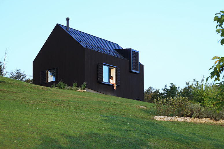 This black wood house in Croatia is designed to reduce heat losses and for better ventilation