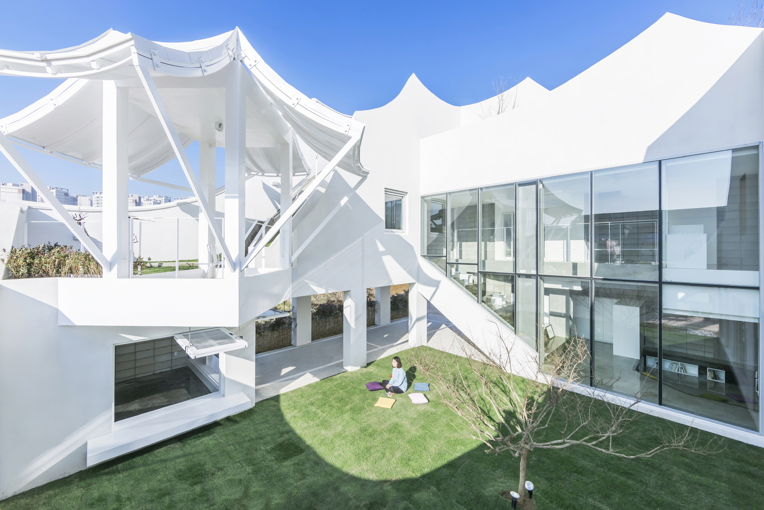 This house belongs to a young pilot and his family and it expresses movement and gives a modern take on traditional Korean architecture