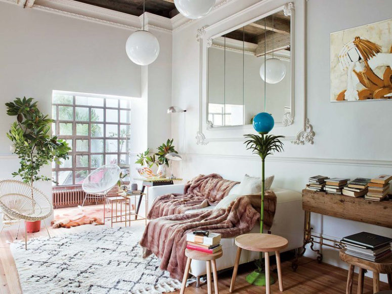 This mid century modern apartment is located in Spain but decorated with soft Parisian vibes