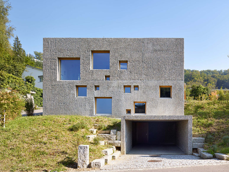 Modern concrete house puntured with square windows digsdigs for Concrete block construction homes