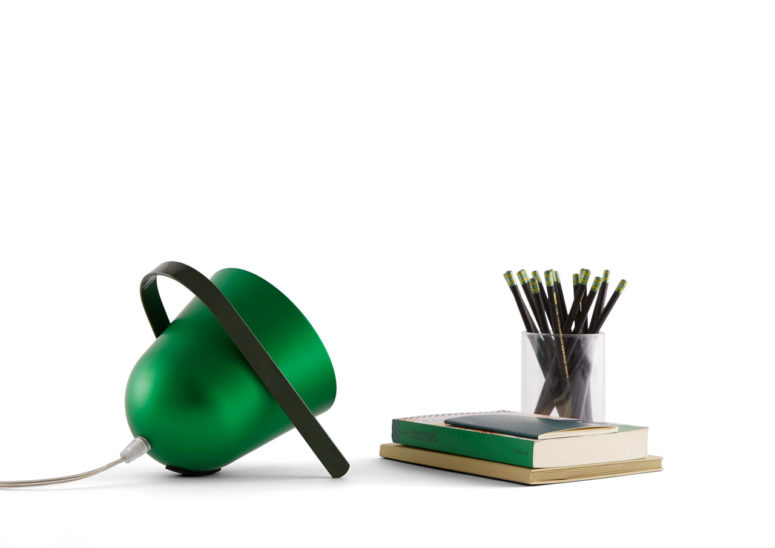 Elmetta portable table lamp is a perfect idea for a modern space, it's simple and creative