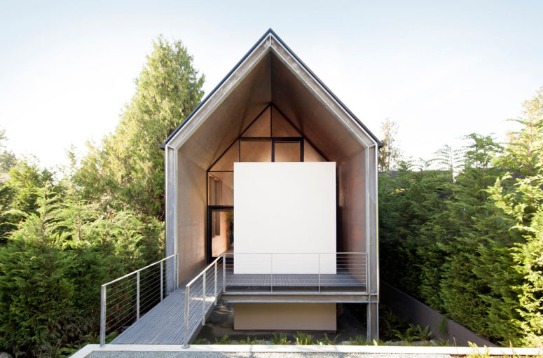 this minimalist house was designed to escape from the everyday life and its hustle and to merge with nature