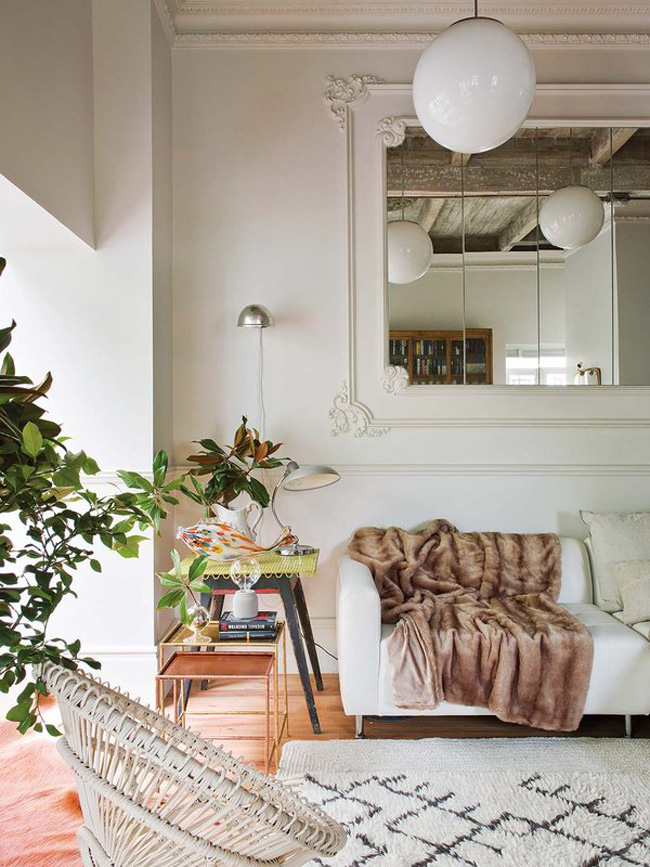 Soft textiles make the space inviting, and greenery enlivens it