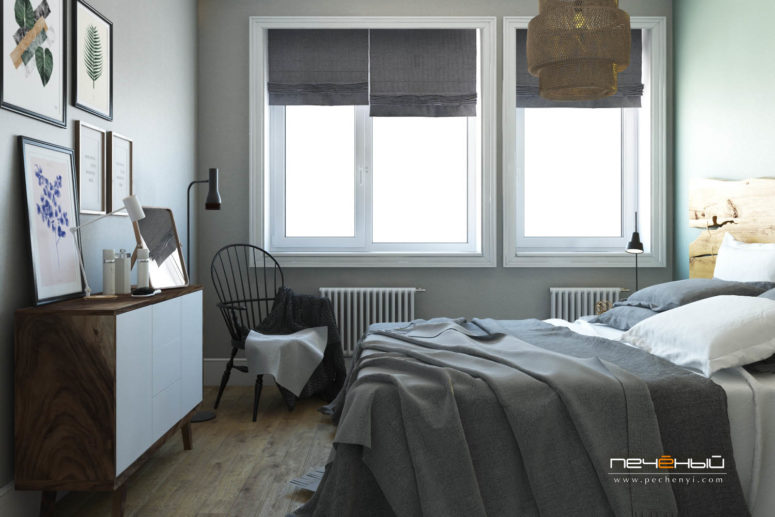 The bedroom is done in light grey and with warm woods, botanical artworks enliven it and raw wood makes the space cozier