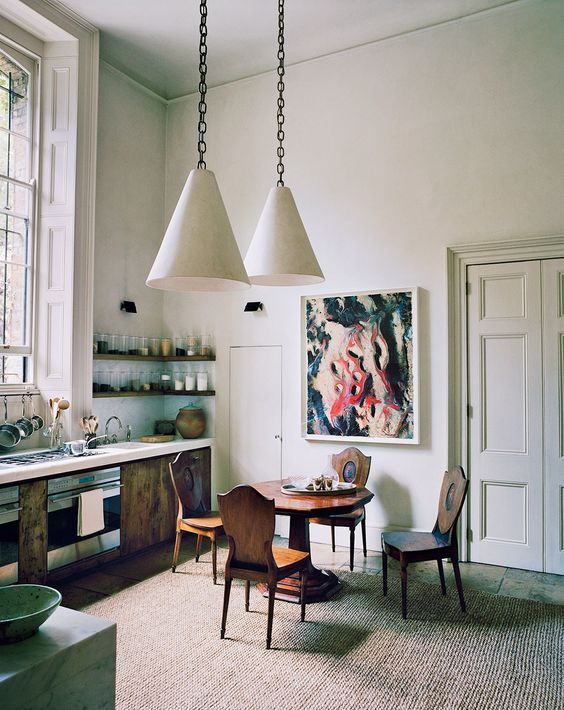 The Kitchen Features Rustic Furniture, A Bold Artwork And Industrial  Inspired Pendant Lamps,