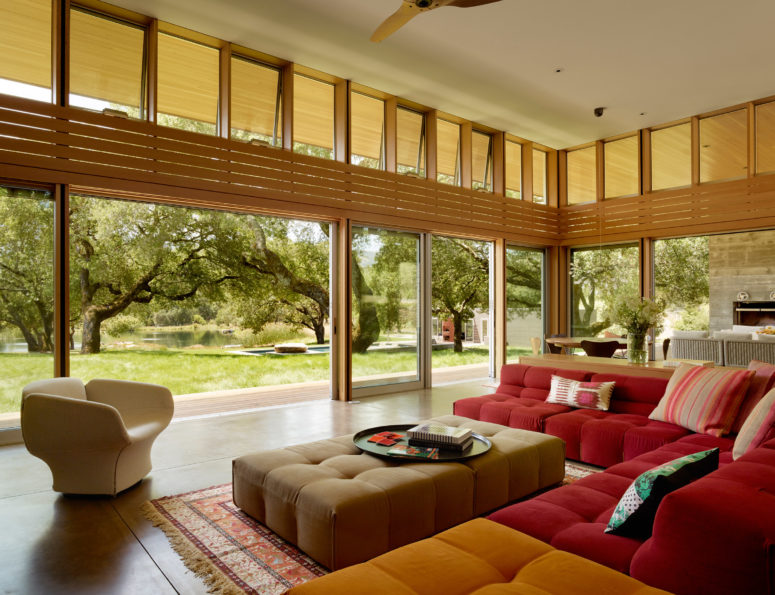 The living room is colorful, and can be opened to outdoors with glass doors