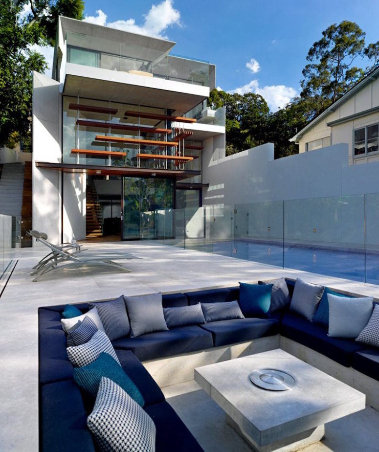There's an outdoor sunken conversation pit of concrete decorated in the shades of blue