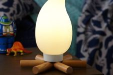 02 a campfire night light is perfect for a woodland or camping themed room