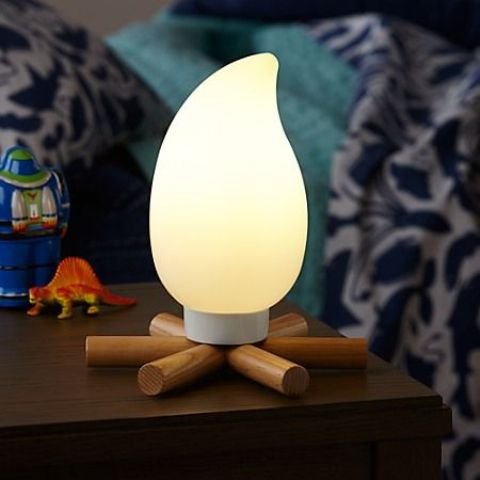 a campfire night light is perfect for a woodland or camping themed room