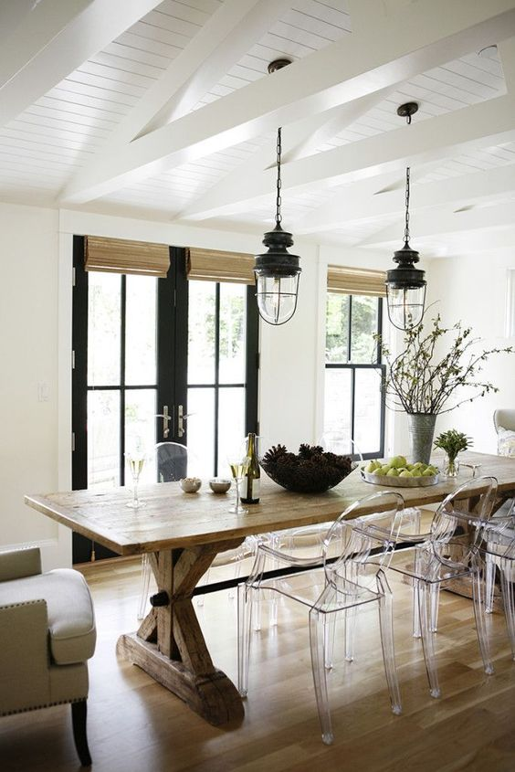 a cozy rustic dining space with acrylic chairs