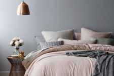 02 a girlish bedroom with a copper pendant lamp that completes the color scheme in a perfect way