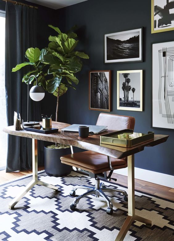 a raw wood edge desk on metal legs is a nice idea for this mid-century modern space