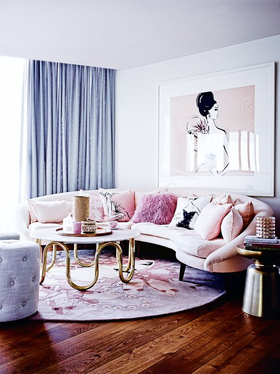 a rounded blush sofa with graphic and pink fur pillows is a great idea for a girlish space