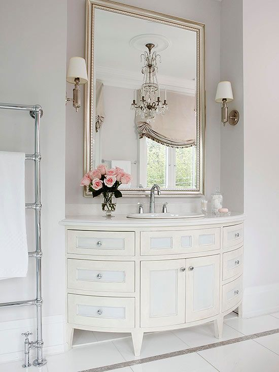elegant rounded bathroom vanity with lots of storage inside