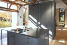 02 modern kitchen with a roll up garage door to enjoy the views whole cooking and eating
