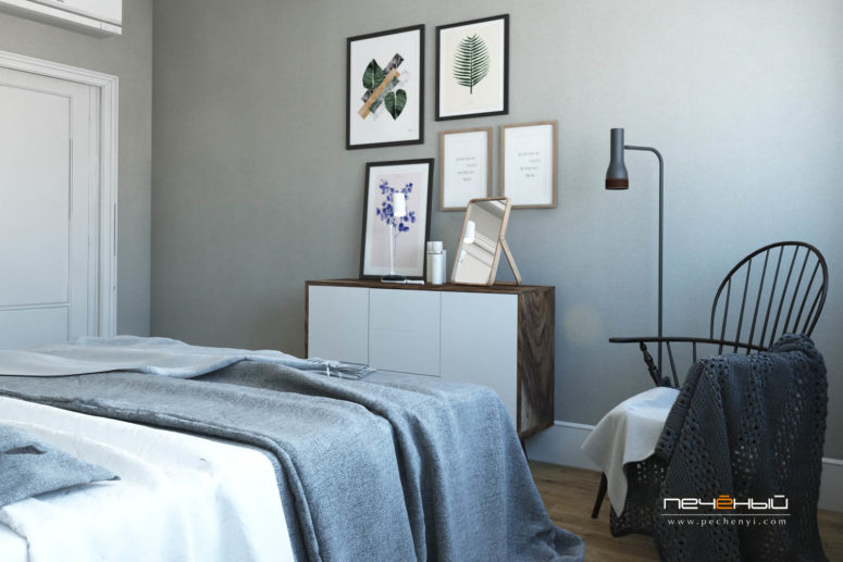 A floating sideboard is nice for storage, some mid-century modern lamps and chairs give a Scandi feel to the space