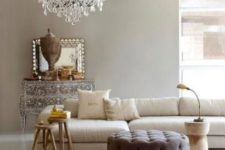 03 French style living room with a modern twist and a vintage glam chandelier for a refined feel