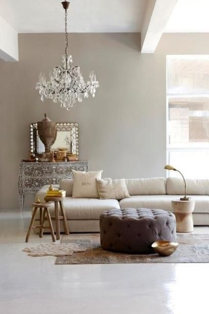 French style living room with a modern twist and a vintage glam chandelier for a refined feel