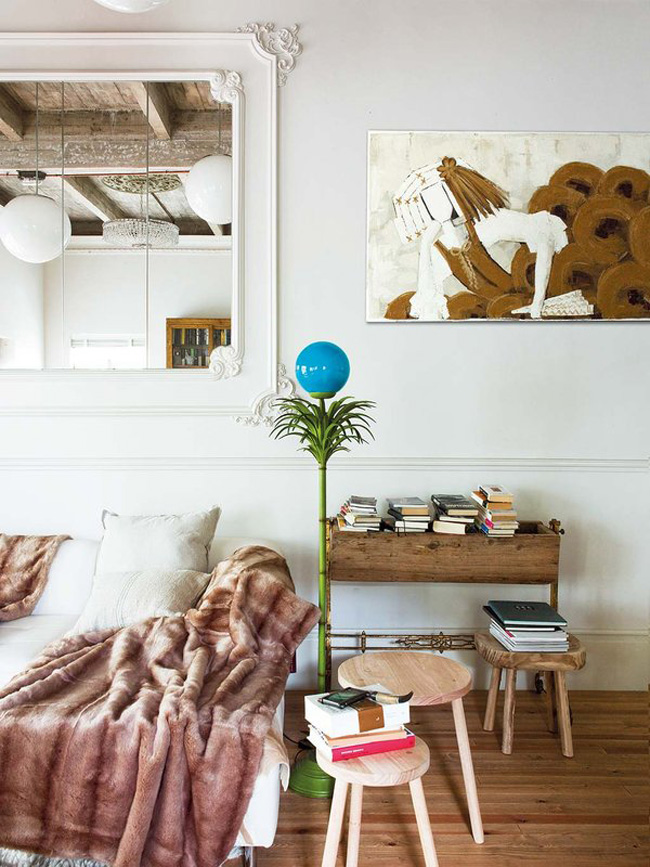 Molding make the room refined, and warm-colored woods make it cozier