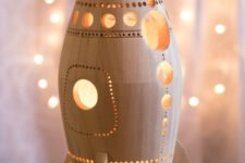 03 a carved wooden rocket lamp is ideal for a space-themed boys' bedroom