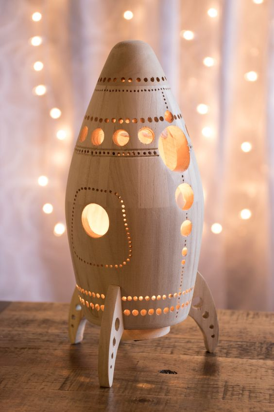 a carved wooden rocket lamp is ideal for a space themed boys' bedroom