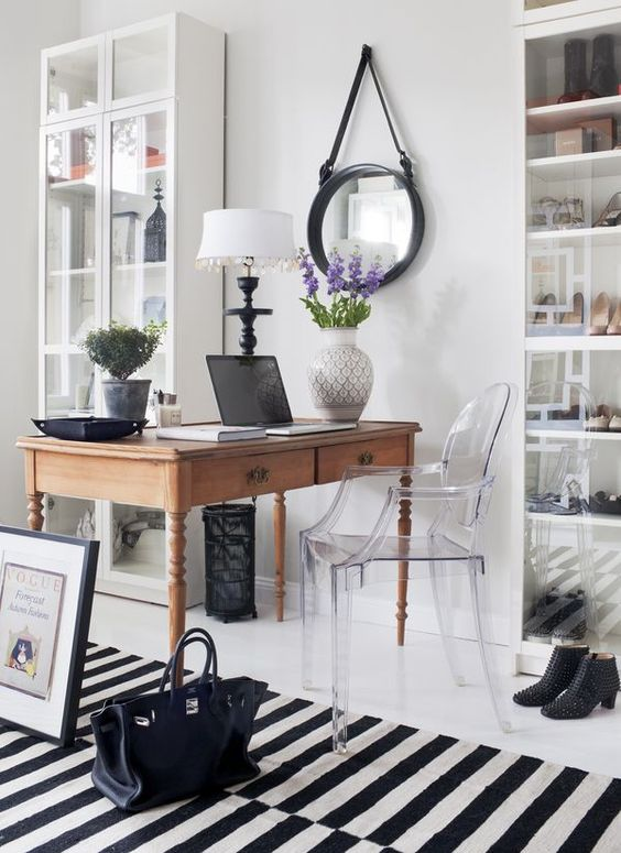 a lucite chair can easily fit almost any space, from a home office to a dining room