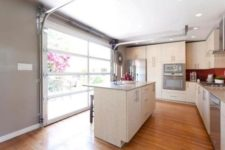 03 install a glass garage door for a bright, open-air kitchen