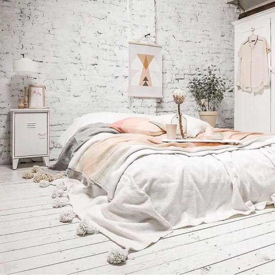 no matter how your bed looks, sometimes soft pastel and off-white bedding with tassels is enough