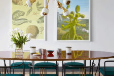 04 Emerald chairs and a mid-century modern chandelier create a style in the dining space, and artworks create a mood