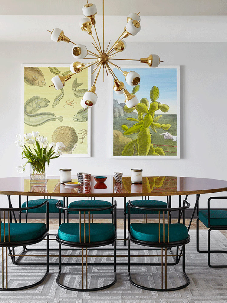 Emerald chairs and a mid-century modern chandelier create a style in the dining space, and artworks create a mood