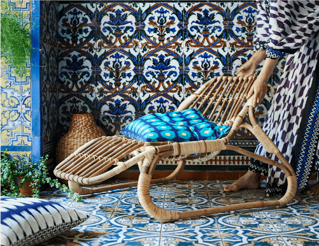 If you aren't ready to dip into the boho vibe, you can use rattan items with calmer fabrics