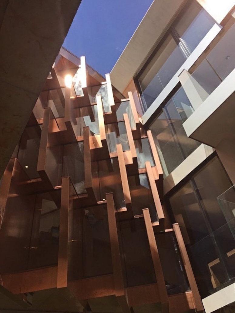 The facade catches an eye with a sculptural design