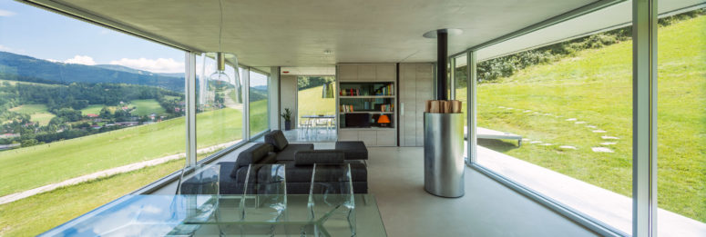 The inside of the home is open plan, with lots of modern materials used - metal, glass, acryl