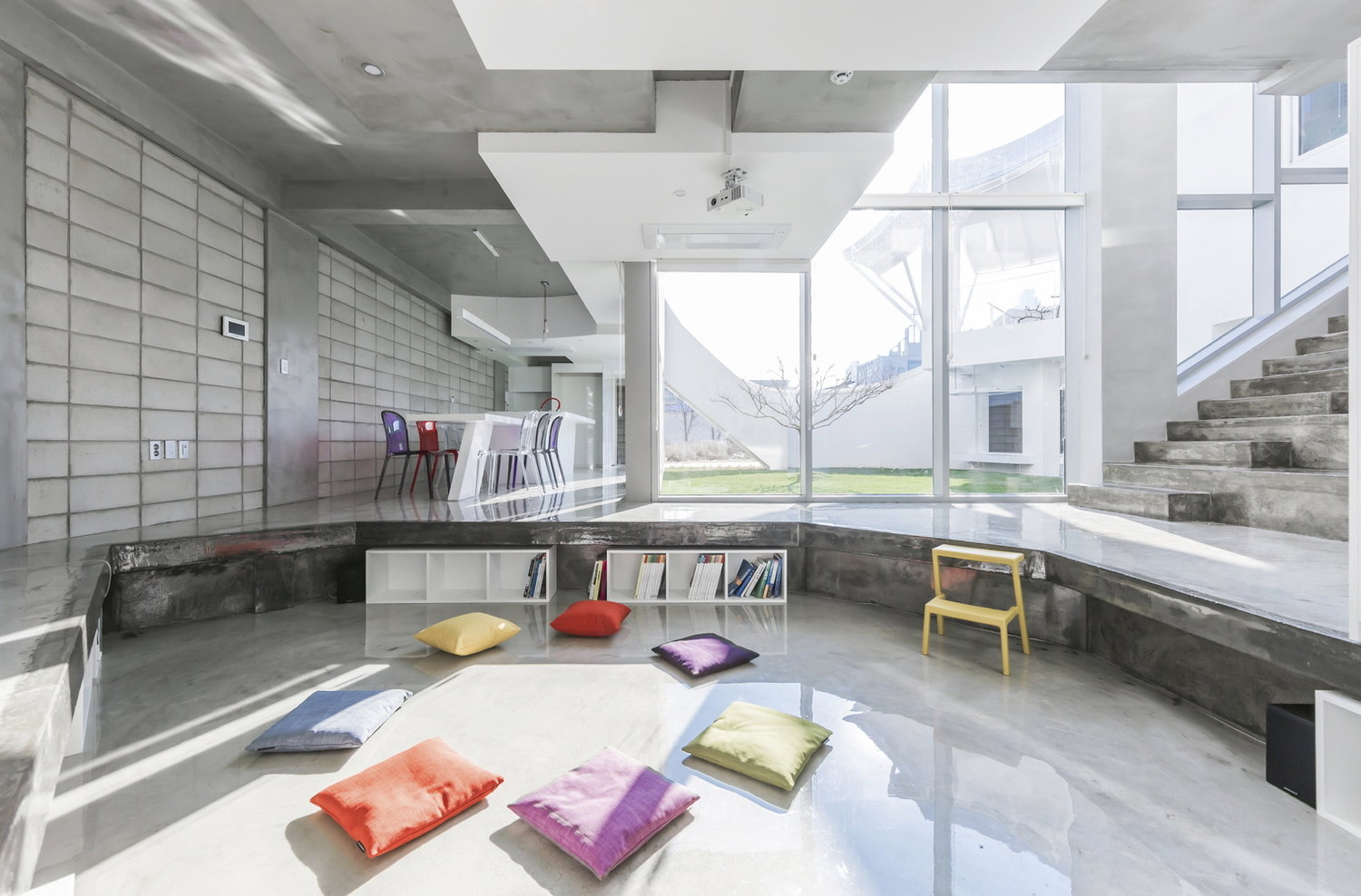 The interiors are between minimalist and industrial, with lots of concrete in decor, which is not only budget savvy but also very durable and modern