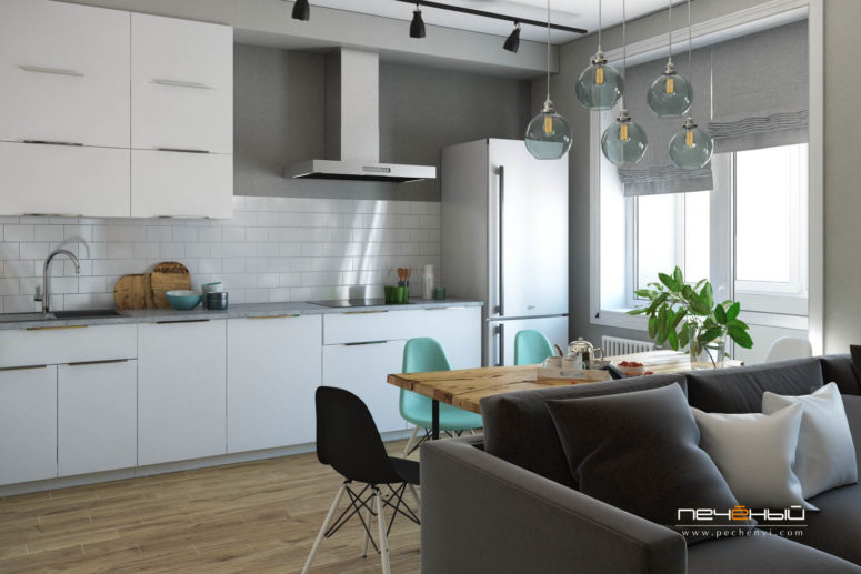 The living, dining space and the kitchen are united into an open layout space filled with light