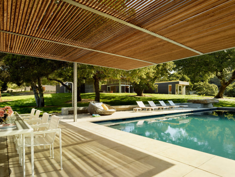 The open plan terrace, a pool and a dining space are an amazing space to live in