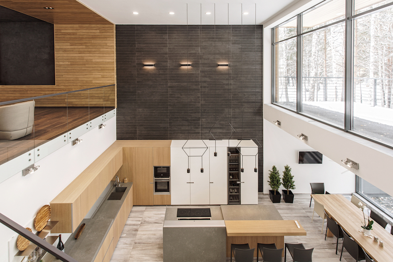 The social area is contained on the lower level and encompasses the kitchen, dining and living spaces