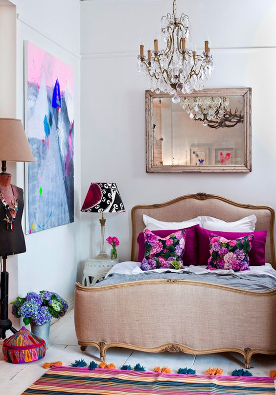 a bold girlish bedroom with a vintage crystal chandlier