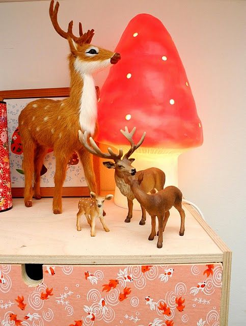 a cute mushroom table lamp and a deer composition for a woodland room