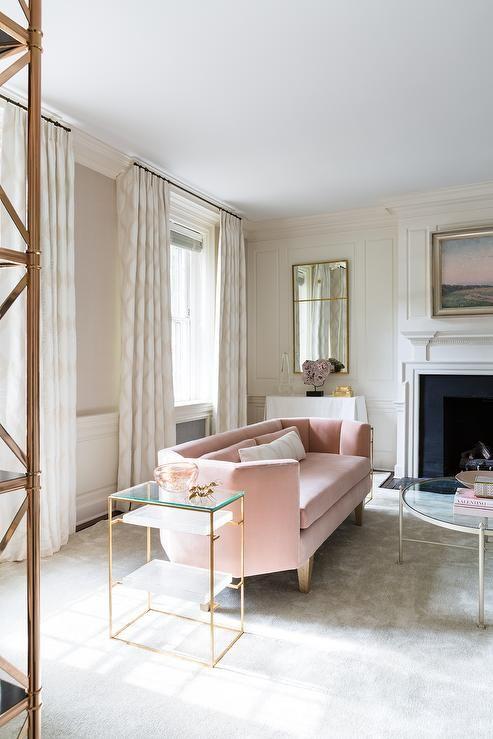 A Modern Living Room Features A Sculptural Pink Sofa On Wooden Legs