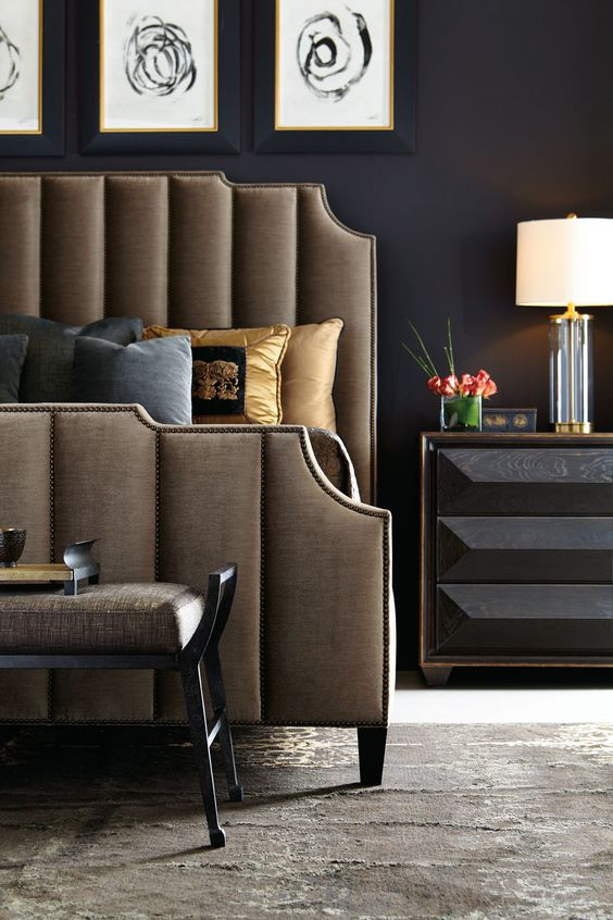 brown upholstered and nailed bed for an elegant space